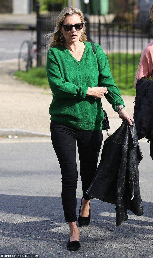Pop of colour: Kate Moss, 43, casual chic in a bright green jumper, which she paired with ...