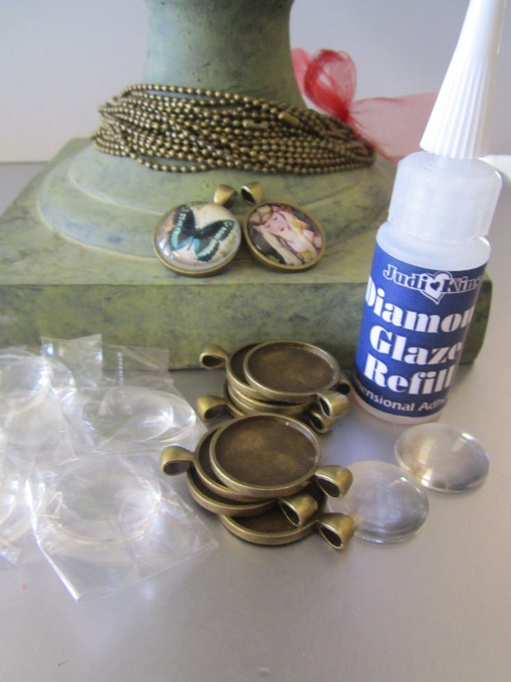 DIY Jewelry 15 Glass Photo Charm Kit Makes 15 Complete Sets Glass Magnifying Domes. $35.00, via Etsy.