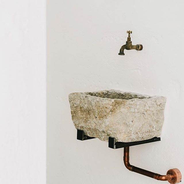 Love the old stone sink we found for the little bathroom off the living room. Photo @salvalopez #masseriamoroseta #ostuni #puglia
