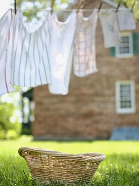 Country Living! Such a romantic idea to hang laundry on the line.....