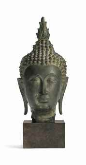 A Bronze Head of Buddha Thailand, Ayutthaya period, circa 14th century 8 7/8 in. (22.5 cm.) high
