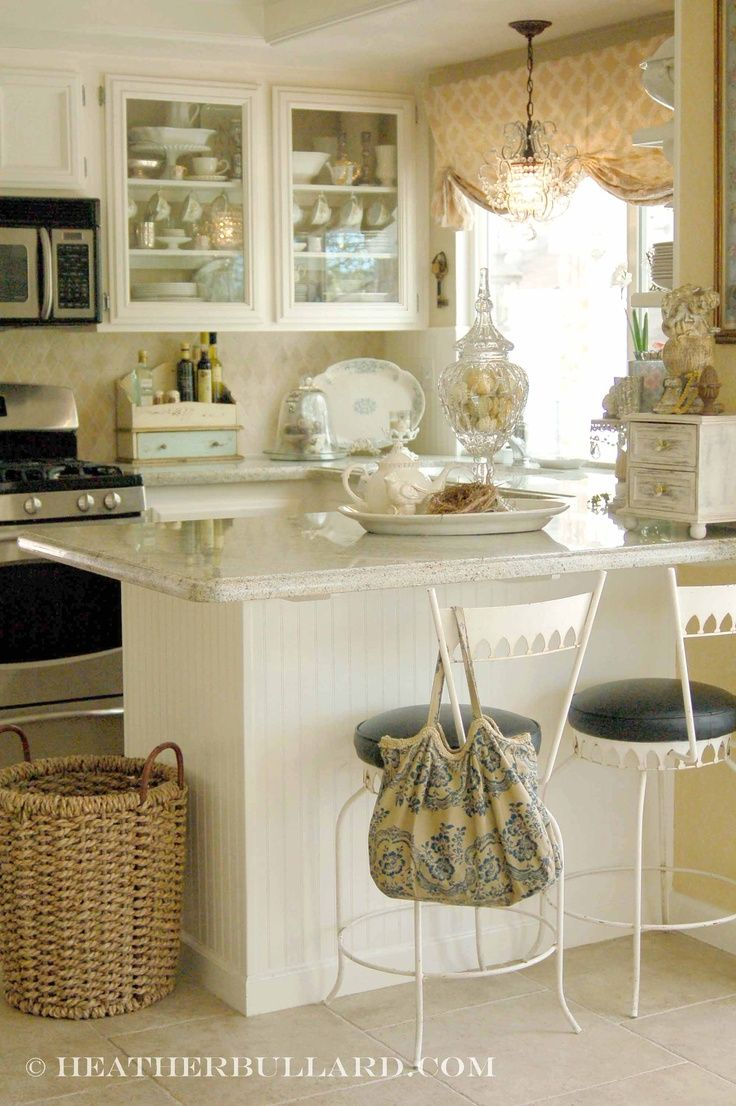 Simple Design Tips For Tiny Kitchens   A Light Color Palette, White  Beadboard And Glass Front Cabinets Make A Small Kitchen Appear Open And  Larger   Via ...