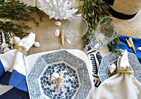 easy DIY rope napkin rings for your blue and white nautical table setting.