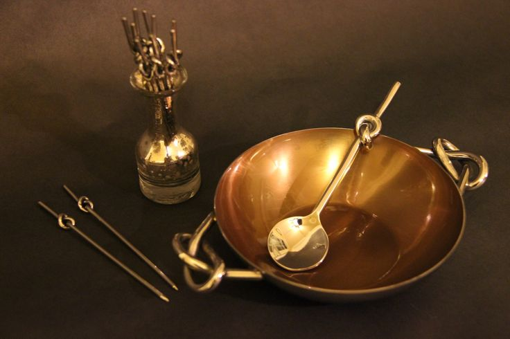 Serving bowl with spoon and skewers