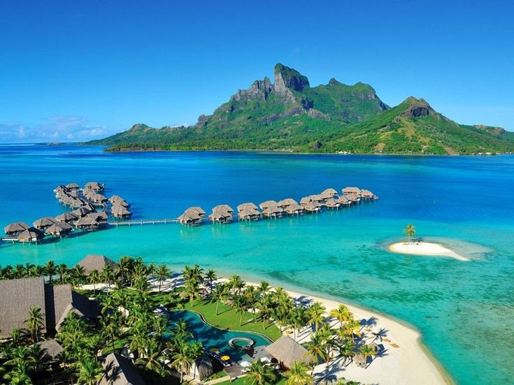 "22. Four Seasons Resort Bora Bora. Sunrise views over the Pacific and sunsets over the lagoon and Mount Otemanu make this Polynesian village resort with a perfect-scoring location ""the most beautiful place on earth."""