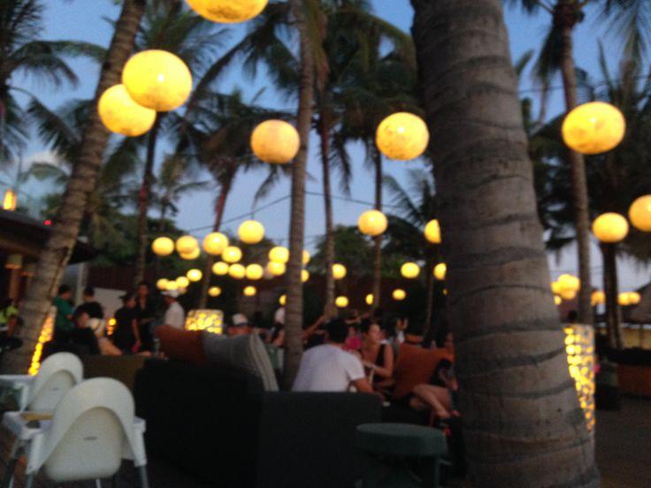The beautiful W Hotel in Seminyak, Bali towards nightfall breaks into a sea of floating lights