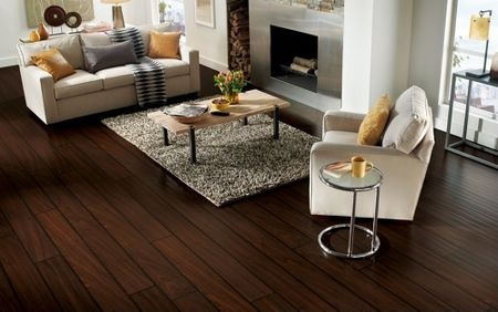 These extra long, extra wide laminate flooring planks add a dramatic touch to this contemporary space. The stainless steel fireplace and modern décor pair well with the luxuriously beautiful graining of the sapele hardwood species - which is reminiscent of mahogany.