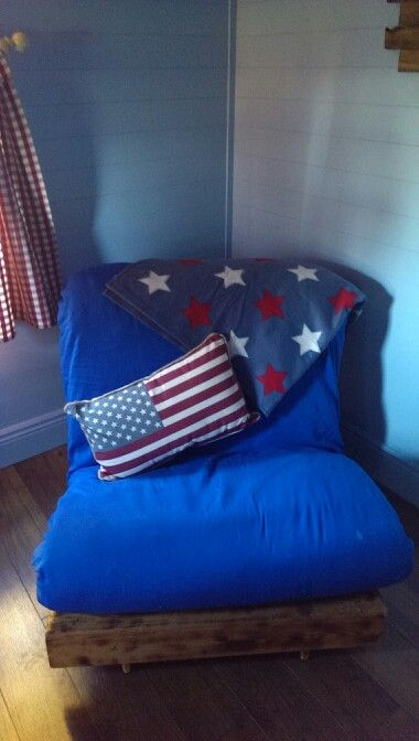 Boys playhouse, ranch themed.. i ordered a navy futon but it hadn't arrived before i had to set up the house. Again, this started out as a regular pine futon before i worked my magic on it..