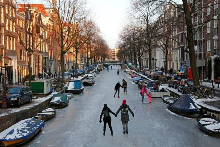 ice skating the frozen canals of amsterdam
