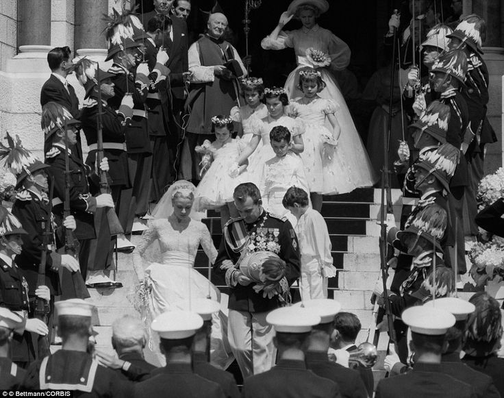 *DEPARTING: Prince Rainier & Princess Grace leave Cathedral of St. Nicholas, followed by the two page boys + 4 flower girls, for a sunny ride in an open Rolls Royce to the Chapel of Monaco's Patron Saint, following their wedding.
