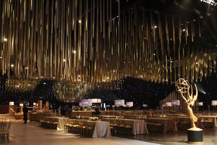 For all three Emmys dinners, Sequoia Productions created a massive ceiling installation made from 5,000 paper cylinders painted with...