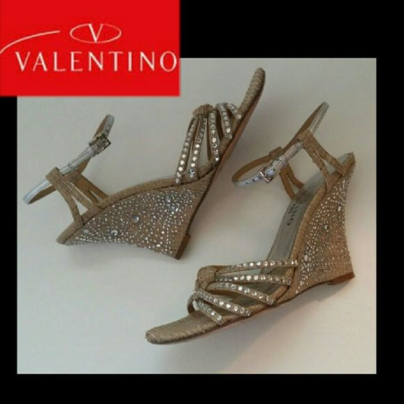 JUST IN Valentino Wedge sandal with crystals Gorgeous Valentino Wedge sandals adorned with Swarovski crystals.  4 inch wedge. Well taken care of. All crystals are present and securely attached. Light wear is specifically shown on last photo including fading of logo on insole, very light toe prints, More photos are available ❎NO TRADES PLEASE ❎OFFERS WELCOME THROUGH OFFER FEATURE ONLY ❎ No lowballs❎ Valentino Shoes Wedges