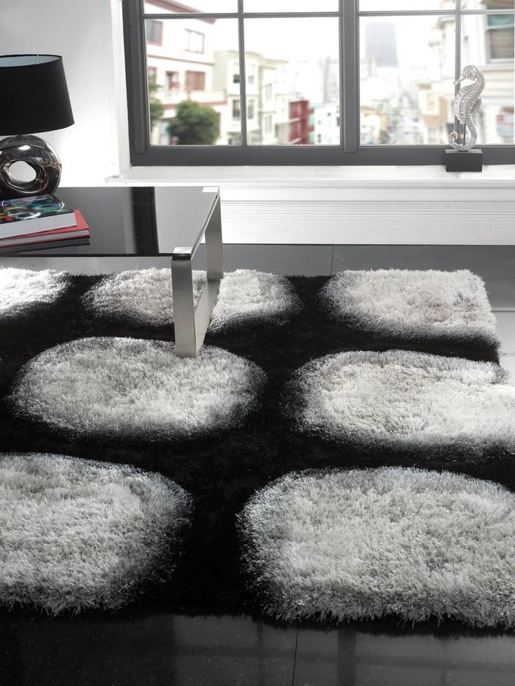 awesome modern shaggy black and gray area rugs decorated in living room with glass top coffee table and small black table lamp