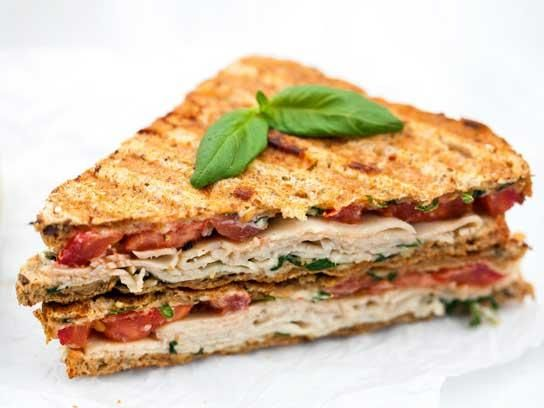 Give your boring turkey sandwich an upgrade with Spache the Spatula's turkey and tomato panini. The spread of Greek yogurt, lemon, basil, and parmigiano reggiano is irresistible.