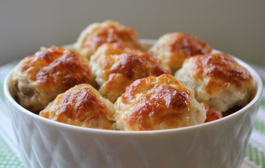Baked meatballs aren't very exciting, but with golden, crisply melted cheese on