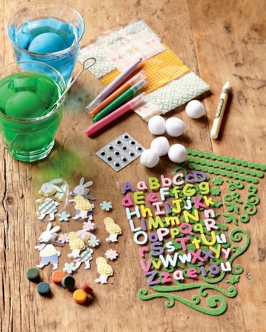 Fun with stickers, pom poms, and googly eyes.  For less mess, skip the dye!