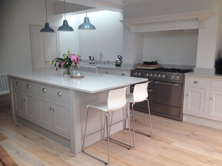 Pale Grey  Shaker with Silestone 'Lagoon' worktop. Mercury range oven.