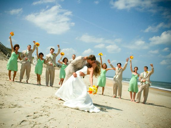 love the dip with the wedding party cheering in the background