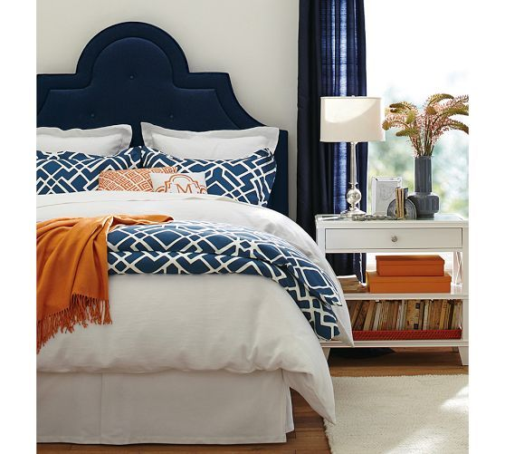 close up of the same shot blue headboard with whitesilver side table navy blue orange and white love the navy headboard orange throw