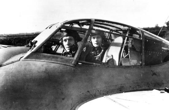 RAF night fighter pilot Eric Loveland and navigator Jack Duffy in the cockpit of their Mosquito March 1945. - Stardust Studios