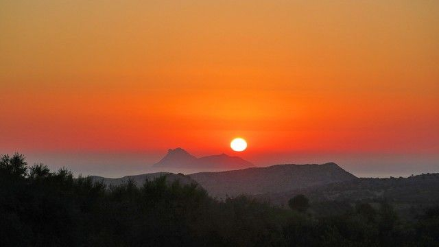 Paximadia... on fire / Sunset over the island of Paximadia, in the middle of September 2014.    - CRETAZINE ♥ #Crete as we live it!