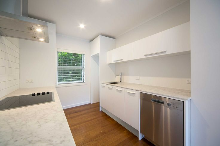 White melamine kitchen designed by Jordan Dale from Gold Kitchens