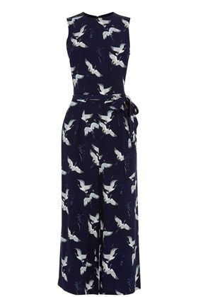 Made in a soft woven fabric, this bird print jumpsuit is a stylish and comfortable addition to your wardrobe this season. Sleeveless and with a relaxed fit, this jumpsuit is finished with a self-fabric tie-waist and two in-seam side pockets. Height of model shown: 5ft 10 inches/178cm. Model wears: UK size 10.
