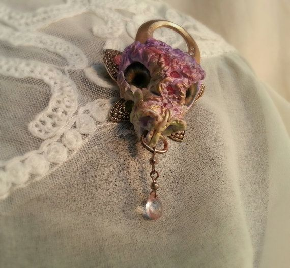 Dragon head brooch, pink and bronze