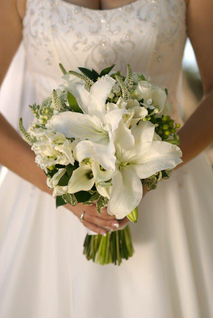 Elegant Bridal Bouquet Showcasing: White Lilies, White Mini Calla Lilies, White Veronica, White Roses, Parrot Tulips, Green Hypericum Berries + Green Foliage