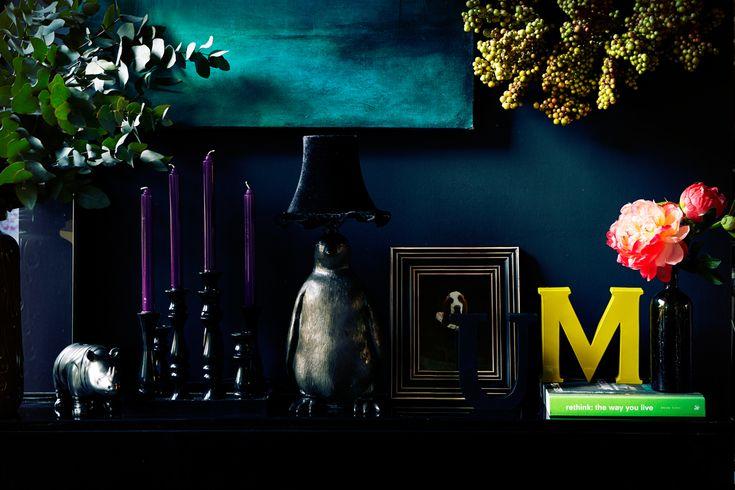 moody deep prussian blue walls + neon pop + abigail ahern lamp + animal theme