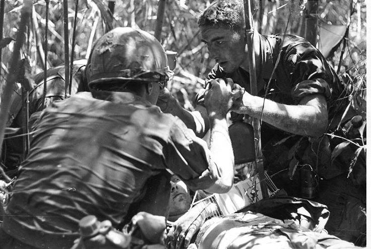 Somewhere in Vietnam. He lost his arm, but otherwise was ok. The medic is the one without the helmet - he was killed in action September 1968. This photo was taken by Earl Van Allstien, battalion photographer The medic is Kenneth Kotyluk and served in the 101st Airborne Division. - Vietnam War