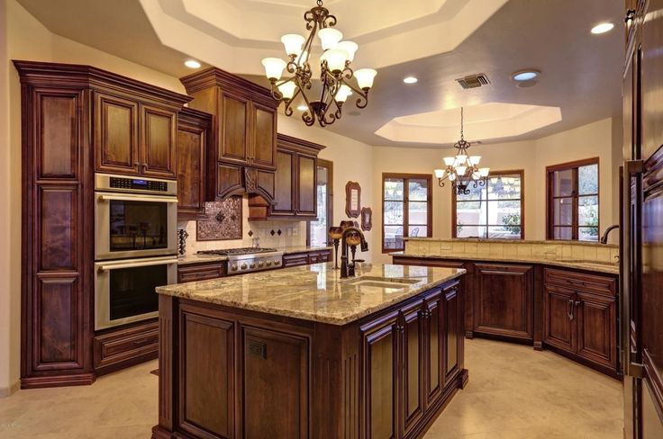 Traditional Kitchen with Stone Tile, Victorian Pull-Down Kitchen Faucet with Magnetic Docking Spray Head, Raised panel, Flush