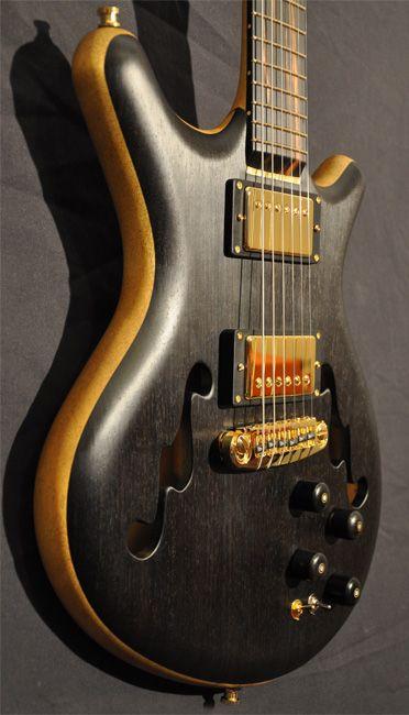 Alexander James Guitars - Custom guitar luthier specializing in exotic woods.