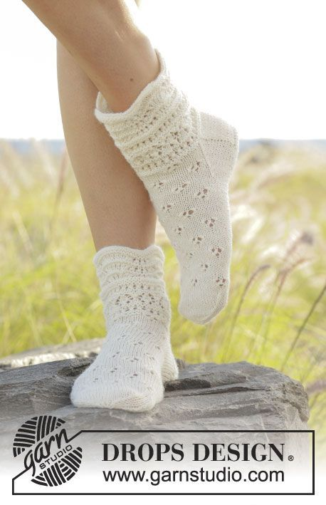Almost Spring socks with lace and wave pattern by DROPS Design  Free Knitting Pattern