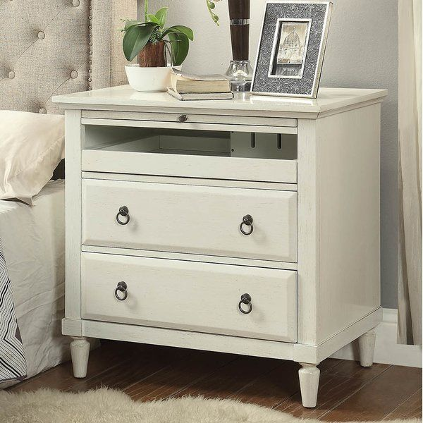 This Hamon 2 Drawer Nightstand with Charging Station is a versatile piece of furniture. It features a slide-out drawer that contains a hidden charging station so you can charge your electronics by your bedside within arms reach or hidden.