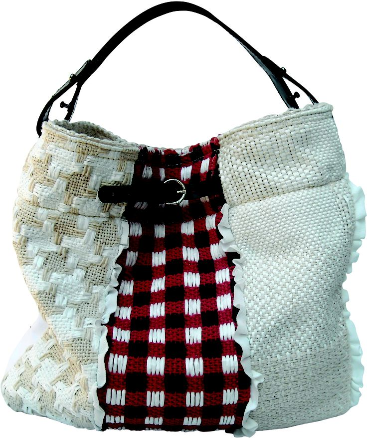 Back side of the Scarabeo bag in handwoven fabric patchwork white. leather handle.