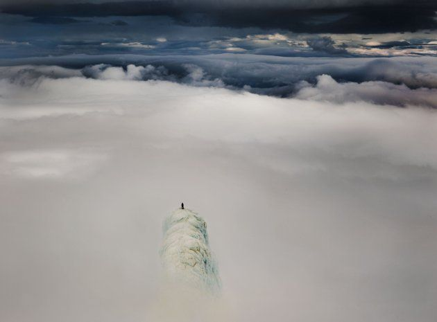 In this other-worldly moment, lone climber Remi McMurty appears to have been pictured knocking on heaven's door on top of the 4,744-foot high volcano Snæfellsjökull in Iceland. (Will Copestake/Caters News)
