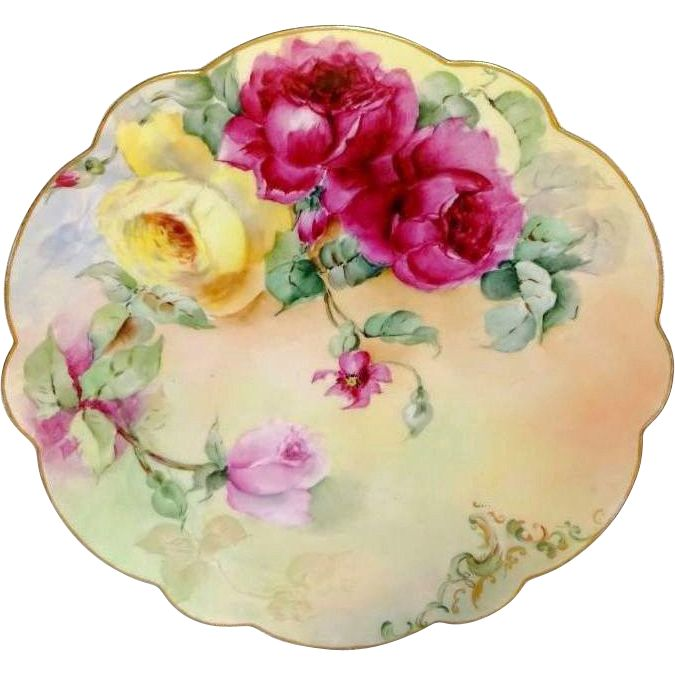 Offered for sale is this breathtaking, Limoges charger featuring, as its centerpiece, a beautiful, Victorian spray filled with English Garden, tea