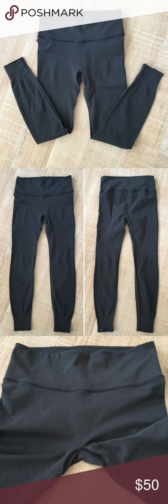 """LULULEMON Perforated Charcoal Leggings Lululemon Perforated Charcoal Leggings. Size is unmarked, but seems to fit a 4 or 6. Please use measurements to best gauge fit. Overall good condition. Some pilling, but not overly so. Most of the wear is at the crotch, please see all photos. Logo at the bottom of the leg, inner pocket. Unique style! No trades, please. Thank you. 👉waist flat: 13"""", front rise: 9"""", inseam: 25"""" lululemon athletica Pants Leggings"""