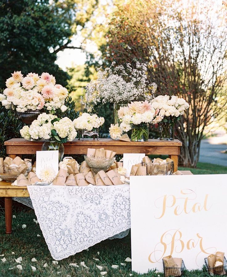 """This bride took her wedding exit to the next level with an adorable """"Petal Bar"""" where guests grab their favorite  blooms to toss after the  ceremony  