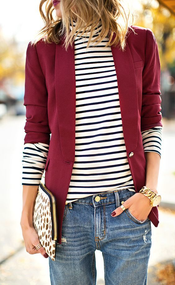 Shop this look on Lookastic: https://au.lookastic.com/women/looks/blazer-turtleneck-boyfriend-jeans/17833   — White and Black Horizontal Striped Turtleneck  — Red Blazer  — White Leopard Suede Clutch  — Gold Watch  — Blue Boyfriend Jeans
