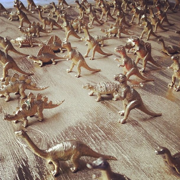 Toy dinos spray painted gold - we cut a slit in their back and used them as place card holders.