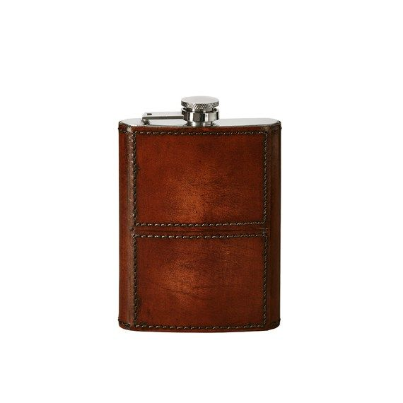A luxurious stainless steel hip flask for your favourite tipple, upholstered in stylish nut brown leather. It's hard to find presents for men and our pocket-sized Saddle Leather Hip Flask ticks all the boxes for originality, practicality and style. This would also make a great wedding gift for the groom, or a thank you gift for the best man and ushers. Part of our Saddle Leather range.