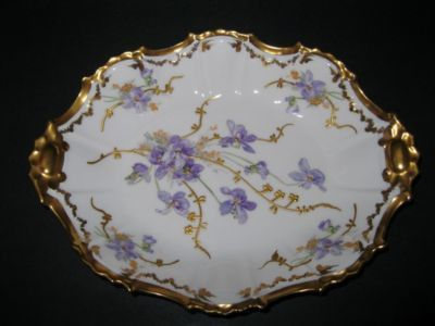 RARE ANTIQUE FRENCH LIMOGES SERVING PLATE PLATTER Stunning rare French Limoges Serving Plate/Platter measures 10 x 8 and stands 1 1/2 deep. This gold encrusted tab handled platter was expertly han