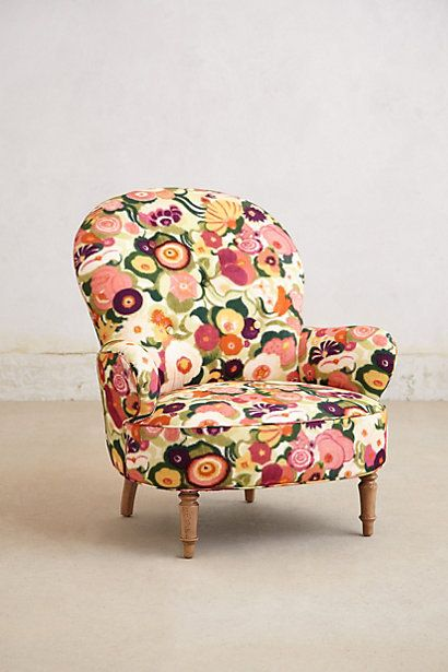 I like the idea of having a funky multicoloured chair and picking out one or two of the colours to use as accents in an otherwise neutral living area