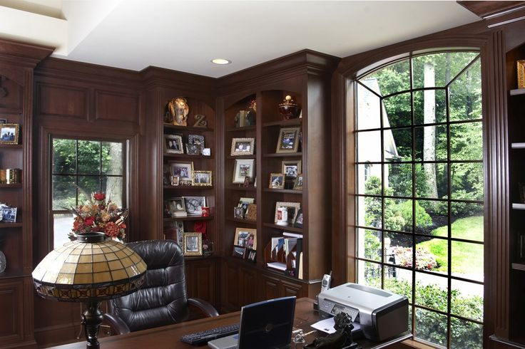 Cherry library and office  This custom cherry library and home office features solid cherry wood wainscot, over sized crown molding, fluted columns, storage cabinetry with mitered corner doors, and bookcases with fluted stiles and curved valances. Even the window lattice was custom made of solid cherry. There is a dedicated media wall, wet bar, and office space. Both rooms were custom designed by A Cut Above, LLC working directly with the client.