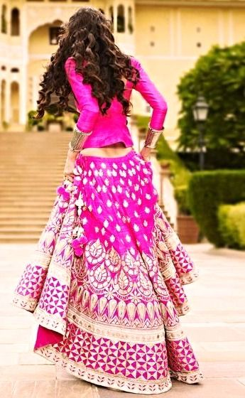 Stunning fuschia lehenga by: Anita Dongre. Love the long sleeves, and her hair! #Want!