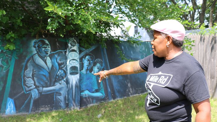 Detroit's Birwood Wall is now decorated with murals — children playing, Detroit Tigers, people of all races living in harmony. But when this wall was built in the 1940s, integration was not the goal.