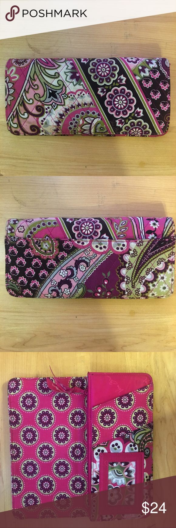 "Vera Bradley TRIFOLD WALLET Very Berry Paisley Don't let its slim silhouette fool you. Inside this timeless trifold design there's everything you need (and want) in a wallet: 11 card slots, three bill pockets and an ID window. vera bradley pattern 063 wallet very berry paisley 	•	Slim trifold design 	•	Hidden magnetic closure 	•	Inside, 11 card slots, three long bill pockets, ID window and photo window 	•	Zippered pocket on back for coins 	•	Measures 8 ¼"" W x 4"" H x ¾"" D 	•	MSRP: $42 	•	Like…"