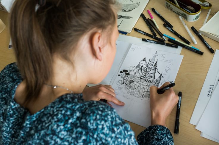 """Jenny drawing the """"City in the sky"""" print."""